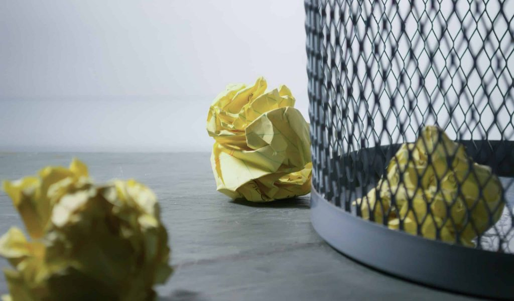 focus-photo-of-yellow-paper-near-trash-can-850216